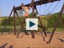 Girl jumping from a swing
