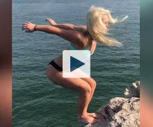 Woman about to backflip