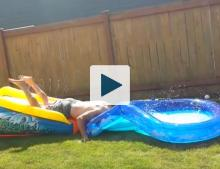Dad failing on pool slide