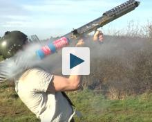 Man shooting fireworks from a homemade launcher