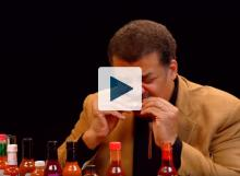 Neil deGrasse Tyson eating a hot wing
