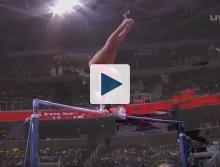 Woman on uneven bars