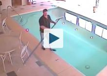 Man about to fall into swimming pool