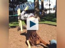 Woman falling off of seesaw