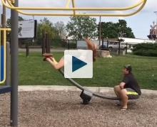 Woman flying off of a seesaw