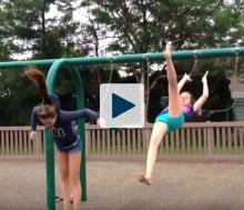 Girls jumping from swings
