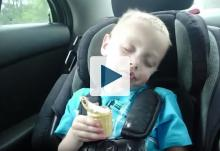 Kid sleeping while holding ice cream cone