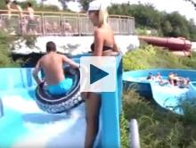Man slipping on water slide