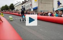 Soapbox derby car flipping over
