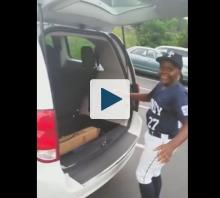 Boy opening minivan hatch
