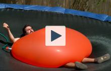 Dan under a 6ft water balloon