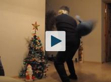 Man about to knock over xmas tree